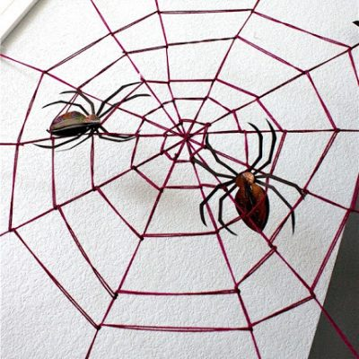 yarn spider web Halloween decoration tutorial from MADE Everyday
