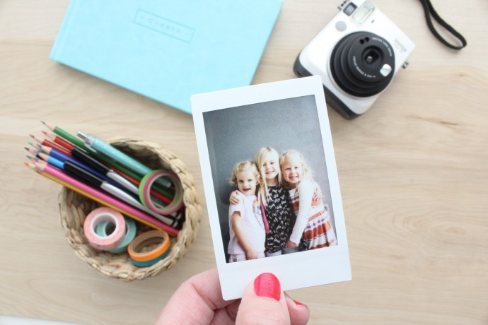 share an instant photo with friends using an Instax camera