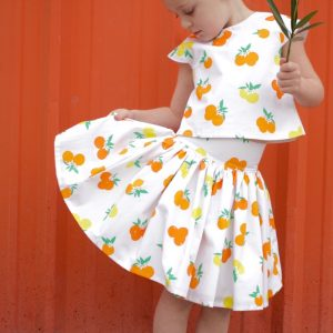 Fiesta Fun fabric collection designed by Dana Willard for Art Gallery Fabrics - Citrus Sunrise print - First Day Dress (top view) and Anywhere Skirt patterns from MADE Everyday